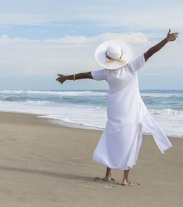 Happy African American Woman Dancing on Beach