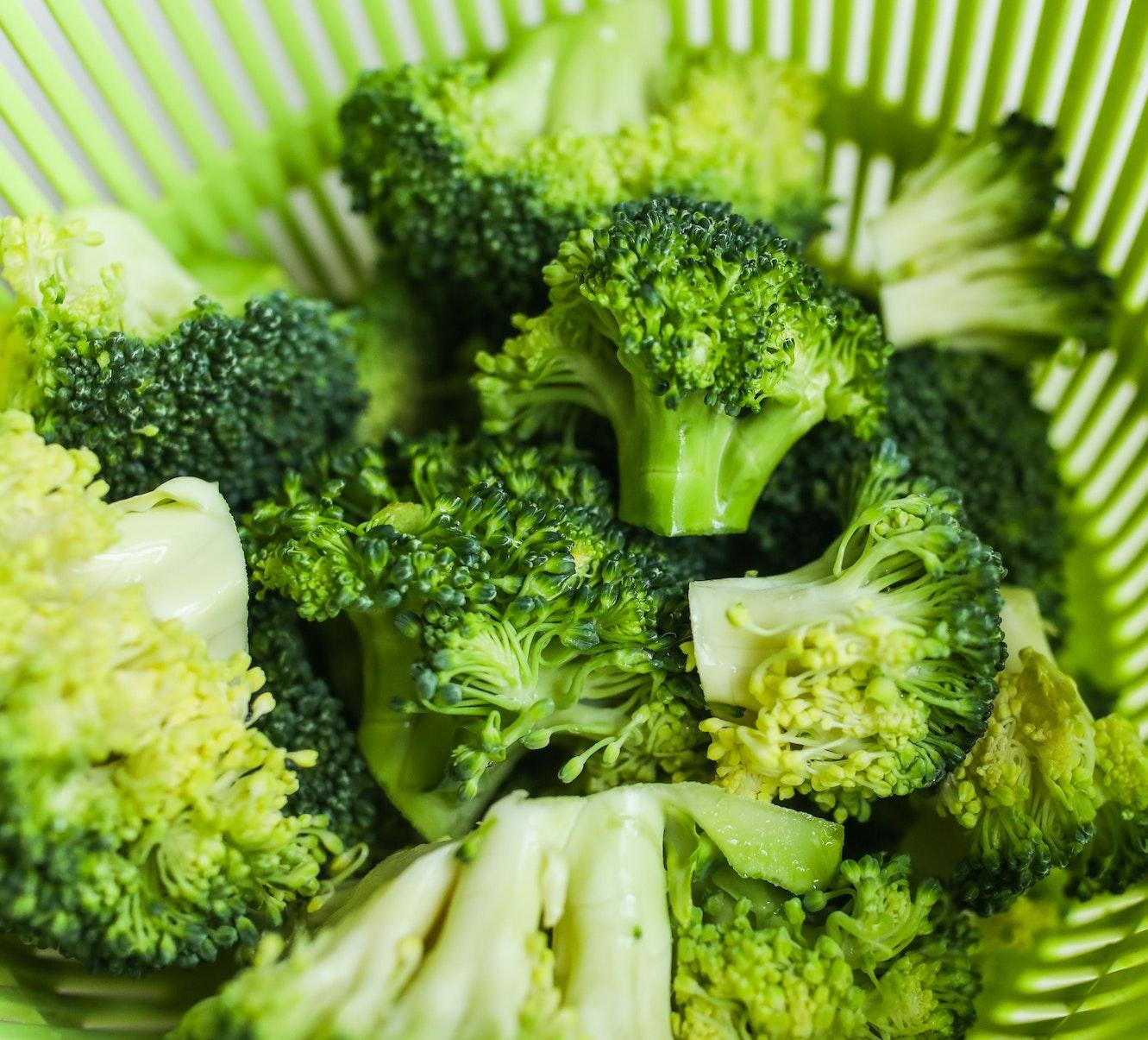 broccoli in a salad strainer basket